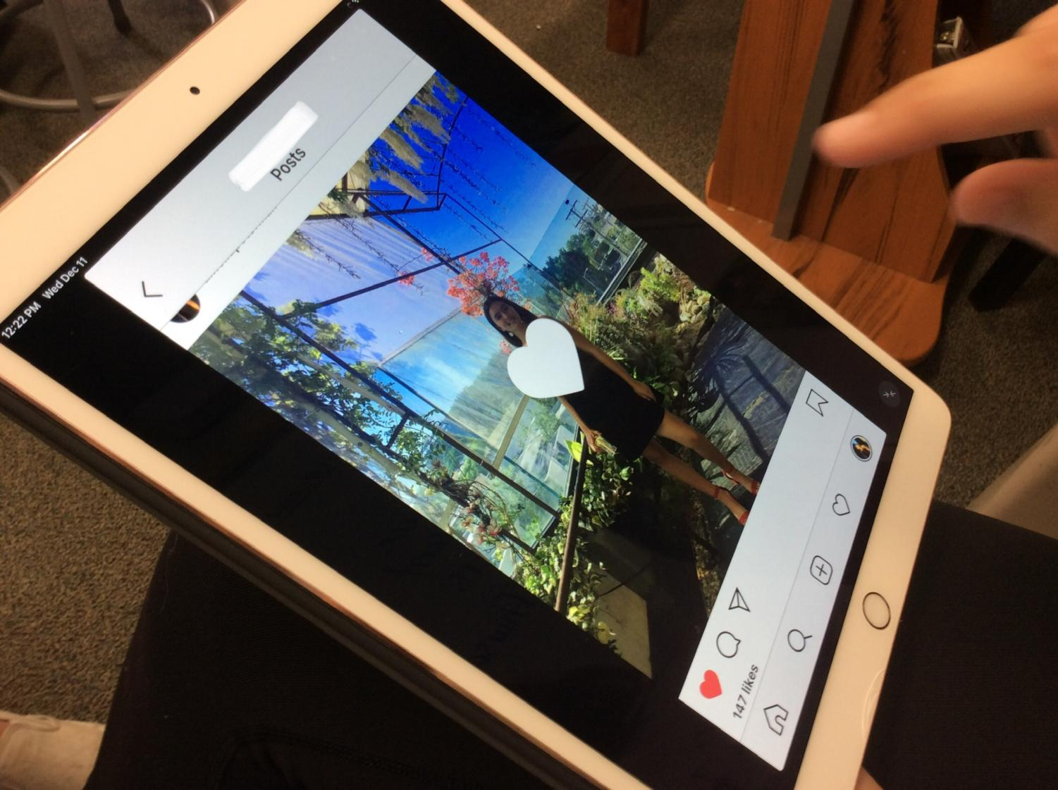 An MBMS student likes a photo on Instagram.