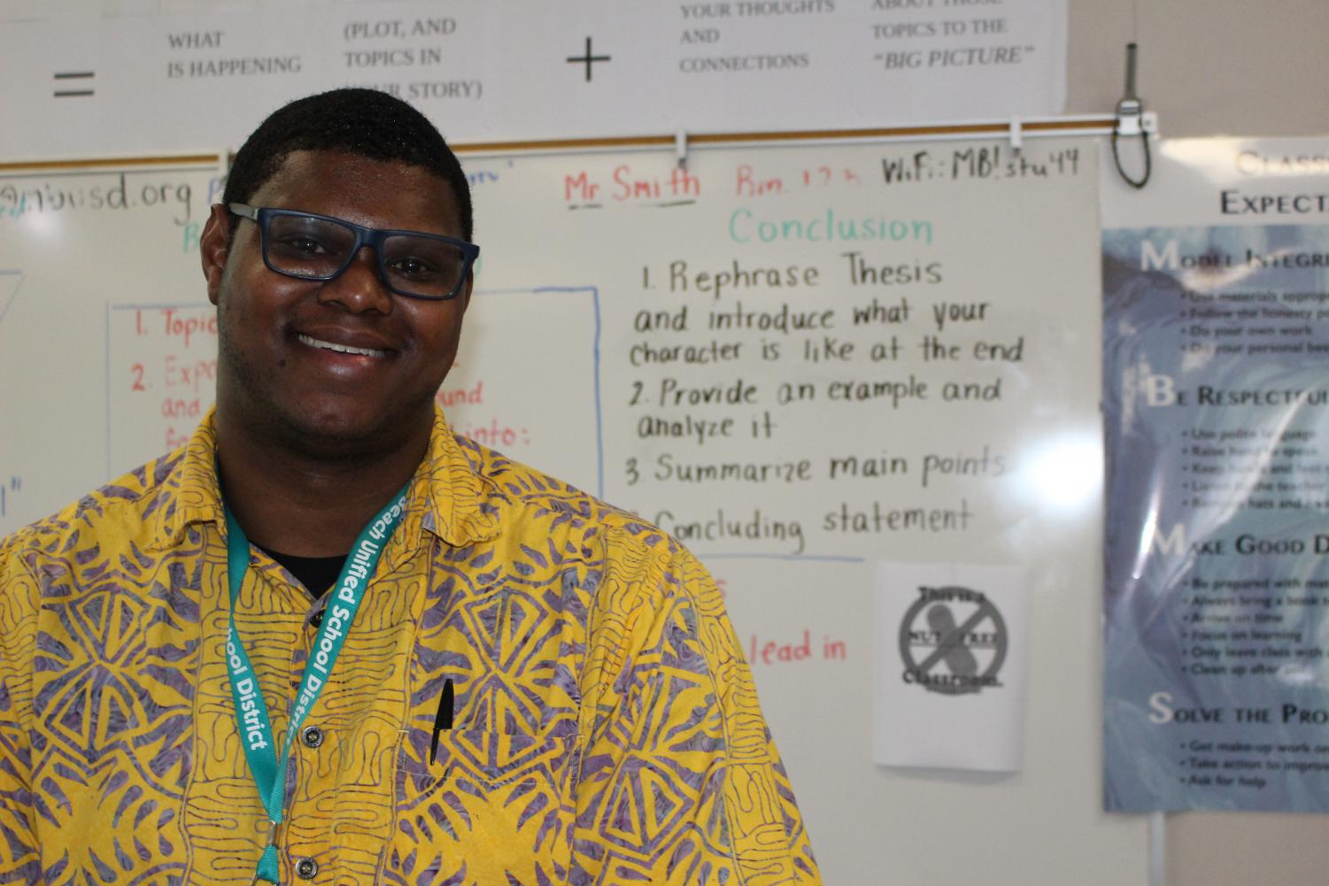 While teaching a fascinating lesson on conclusion paragraphs, Mr. Smith poses for the camera.